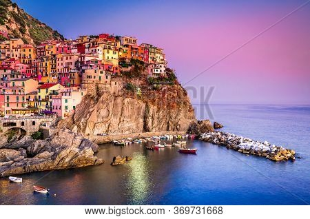 Aerial View Of Manarola Fishing Village In Cinque Terre  In The Evening, Liguria, Italy.