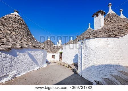 Alberobello, Italy. Traditional Trulli Houses In Alberobello City, Apulia Region Of Italia.