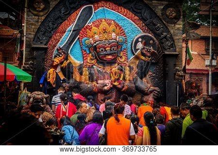 Kathmandu,nepal - June 28,2019: Devotees Worship Kal Bhairav Which Represents Deity Shiva In His Des
