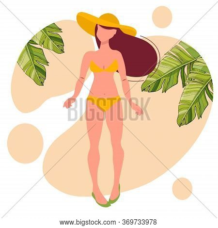 Young Girl In A Wide-brimmed Hat And Yellow Bikini. Resting On The Beach Under Palm Trees.