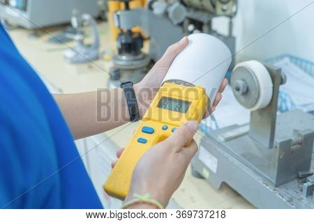 Q.c. Or Quality Control Inspector Or Technician Inspector Using Machine For Paper Tube Cores, Steel