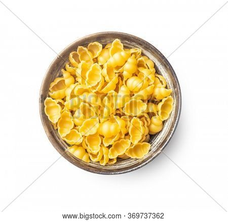 Gnocchi, raw italian pasta. Dried pasta in bowl isolated on white background.