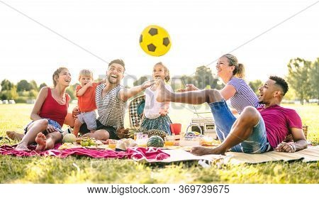 Happy Multiracial Families Having Fun With Cute Kids At Pic Nic Garden Party - Multicultural Joy And
