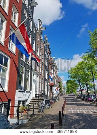 Flags at half mast on memorial day May 4 2020 in Amsterdam the Netherlands