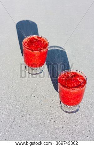 Two Glasses Of Traditional Italian Summer Dessert Strawberry Granita Or Sorbet On Light Background W