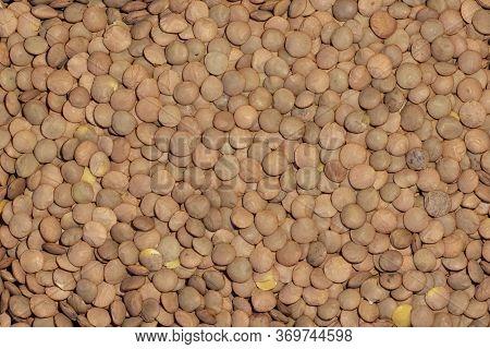 Lentils. Food Background. Background Texture Of Grains Lentils. Top View On Lentil Grains. Close-up,