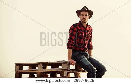 From The Country. Vintage Style Man. Wild West Retro Cowboy. Cowboy Sit On Woden Pallet. Western. Ma