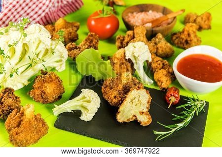 Fried Cauliflower Closeup On Kitchen Table. Vegetarian Food. Cauliflower With Chili Sauce. Healthy V