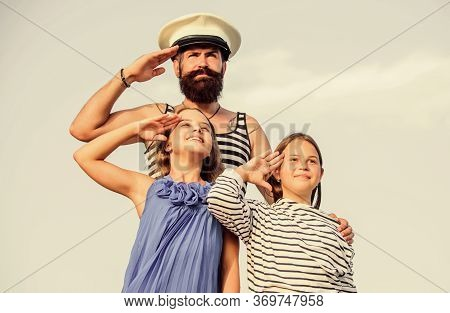 Summer Travel Concept. Happy Family. Dad Sailor And Daughters Outdoors. Captain Welcome On Board. Ma