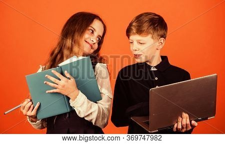 Lesson Period. Small Children Have Lesson Of Information. Little Girl And Boy Use Lesson Book And La