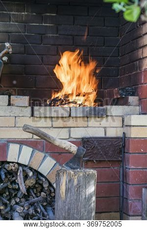 A Bricked, Barbecue Stove With Barbecue With Flaming Fire From Charred