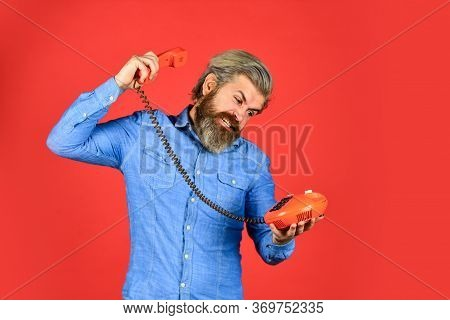 Future Of Advertising. Senior Man Hipster Showing Old Telephone. Brutal Guy With Telephone. Mature B