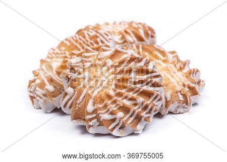 Group of cookies drizzled with white chocolate isolated over white background