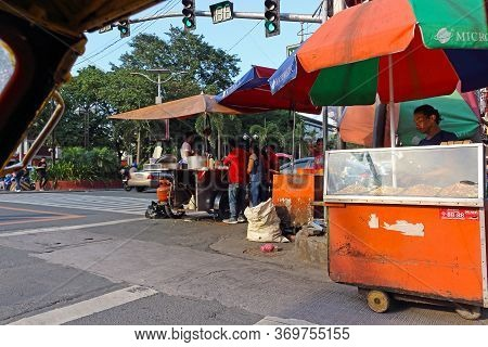 Manila, Philippines - September 24, 2018: View Of A City Street With Street Vendors In Manila, Phili