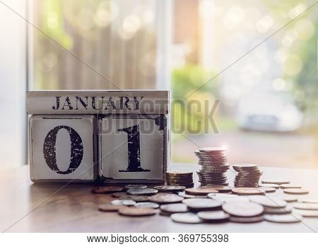 First Of January With Stacks British Pound Coins, Financial Planing For New Yew 2021or New Year Reso