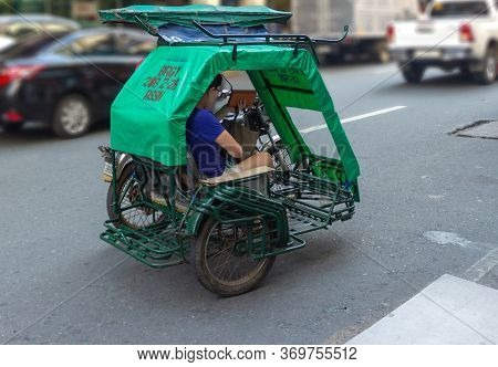 Manila, Philippines - September 24, 2018: Small Tricycle Motorbike Taxi On City Street With Passenge