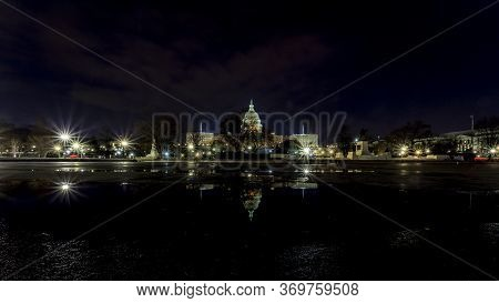 The Capitol In Washington D.c., United States Of America At A Cold Night In Spring With Reflections