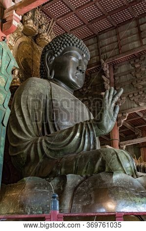 Daibutsu Large Bronze Statue Of Buddha In The Todai-ji Temple In Nara, Japan