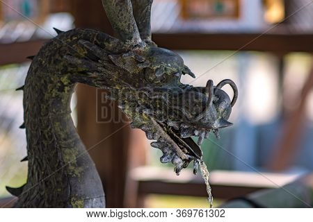 Dragon Shaped Water Tap For Washing Hands At The Entrance Of Shinto Shrine In Nara, Japan