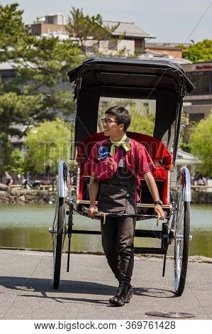 Young Japanese Rickshaw Puller In Nara, Japan