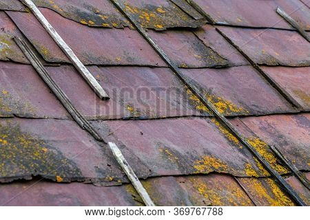 Rusted Sheet Metal Roof With Wooden Planks, Mold And Dirt - Closeup With Selective Focus And Diagona
