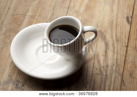 Tilted coffee cup.