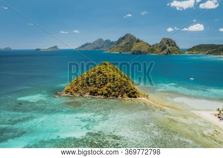 Aerial Drone View Of Las Cabanas Beach In El Nido, Palawan