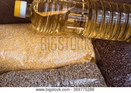 A Bottle Of Sunflower Oil, Packing Buckwheat, Corn And Pearl Grits