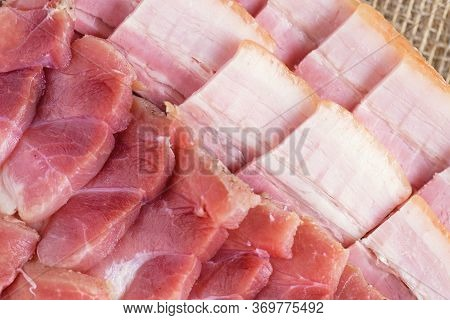 Raw Chopped Bacon For Cooking. Fresh Cooked Food. Fresh Cold Sliced Bacon On The Background Of Natur