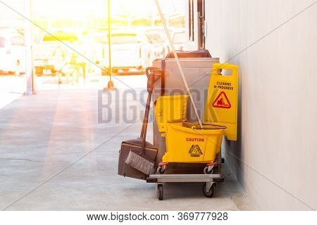 Janitorial Mop Bucket On Cleaning In Process With Copy Space.