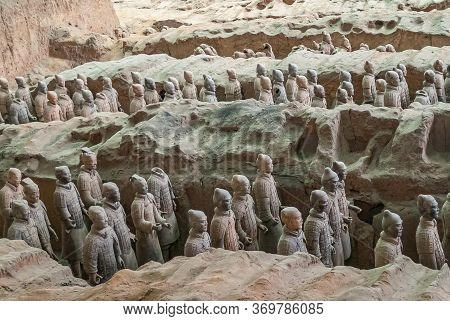 Xian, China - May 1, 2010: Terracotta Army Excavation Site. 3 Trenches Full Of Beige-gray Statues Of
