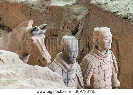 Xian, China - May 1, 2010: Terracotta Army Excavation Site. Chest Closeup Of 2 Beige-gray Statues Of