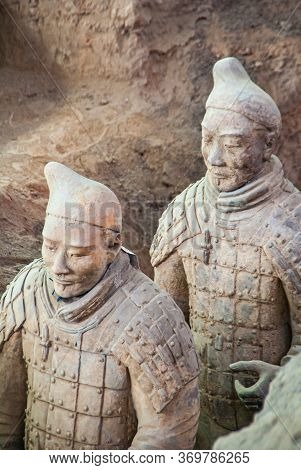 Xian, China - May 1, 2010: Terracotta Army Excavation Site. Closeup Of 2 Beige-gray Sculpture Of Sol