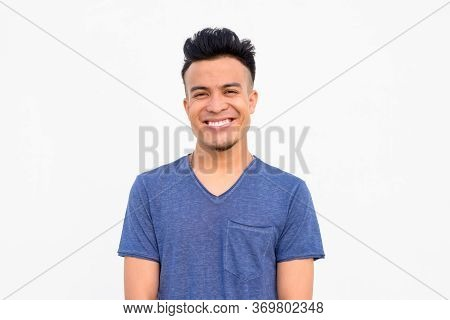 Face Of Happy Young Handsome Multi Ethnic Man Smiling Against White Background