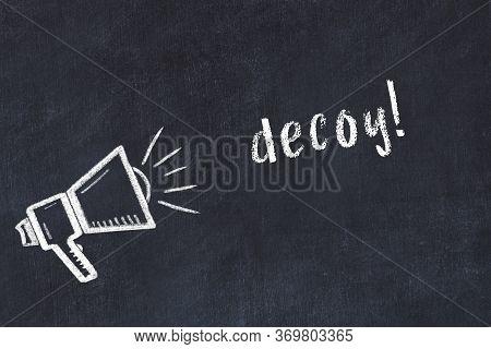 Chalk Drawing Of Loudspeaker And Handwritten Inscription Decoy On Black Desk