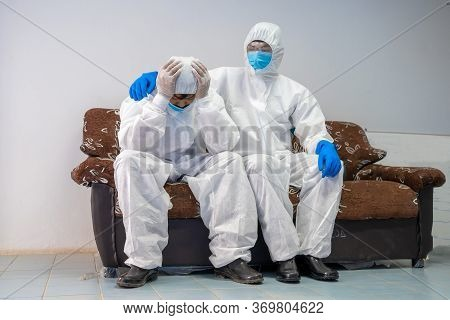 Doctors Encourage Each Other Concept,scientist Team Wear Personal Protection Equipment Or Ppe  Encou