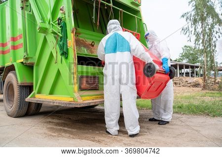 Worker In Hazmat Ppe Protective Clothing Wearing Protective Mask To Protect Against Covid-19 Are Loa