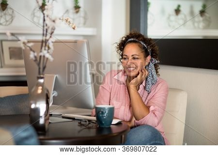 Mixed Race Woman Working From Her Home Office.