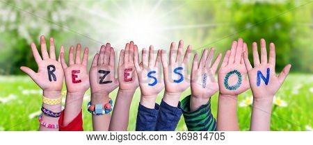 Children Hands Building Word Rezession Means Recession, Grass Meadow