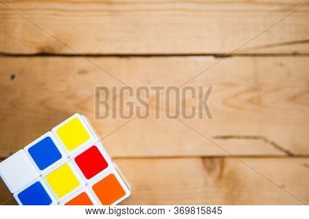 Rubik's Cube On Wooden Background. Puzzle Cube