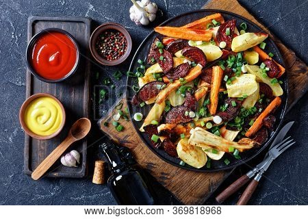 Roasted Sliced Beetroot, Potato Wedges, Parsnips, Carrots Sprinkled With Chopped Green Onion On A Wo