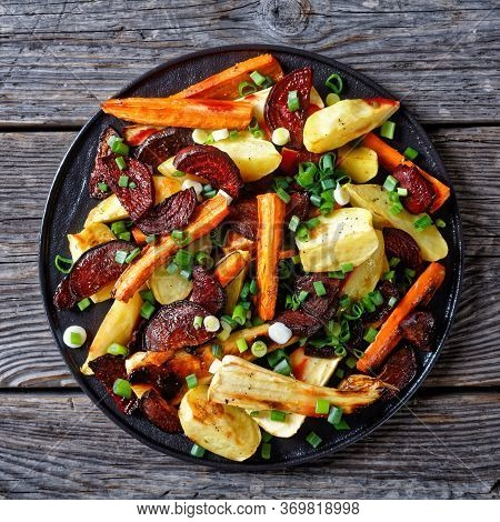 Roasted Sliced Beetroot, Potato Wedges, Parsnips, Carrots Sprinkled With Chopped Green Onion On A Bl