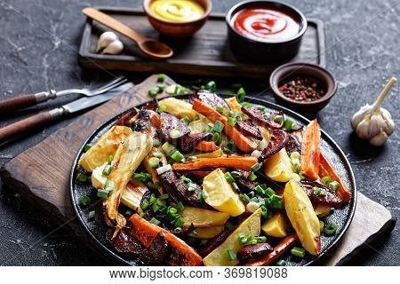 Beetroot, Potato Wedges, Parsnips, Carrots Sprinkled With Chopped Green Onion On A Wooden Board With