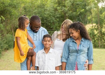 Portrait Of A Multi Ethnic Family Laughing.