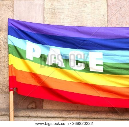 Flag With Many Colors With Text Pace That Means Peace In Italian Langauge