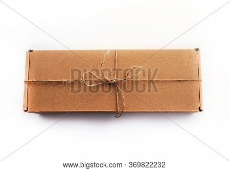 The Brun Squared Present Box On A White Background With Jute Rope