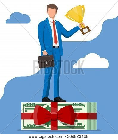 Successful Businessman With Dollar Bundle Holding Trophy, Celebrates His Victory. Business Success,