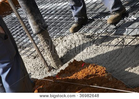 Workmen Pouring Cement For Foundations