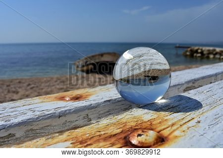 Crystal Glass Ball At The Beach/ Old Boat Reflection In The Glass Ball