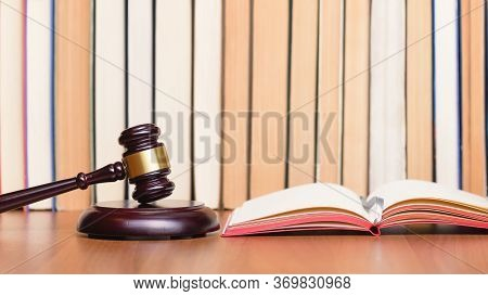 Law Books, Judge Gavel, Legal Code On Judges Wooden Table. Court Hearing. Judge Verdict. Symbol Law.
